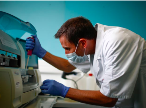 A technician scanning test tubes containing live samples of the coronavirus at the Robert Ballanger hospital near Paris on April 30.